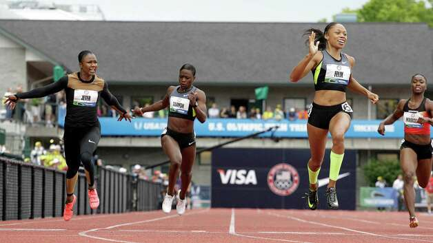 Allyson Felix celebrates her first place finish in the women's 200 meters at the U.S. Olympic Track and Field Trials Saturday, June 30, 2012, in Eugene, Ore. Behind Felix are Carmelita Jeter, left, Jeneba Tarmoh, second from left, and Tianna Madison.  (AP Photo/Eric Gay) Photo: Associated Press