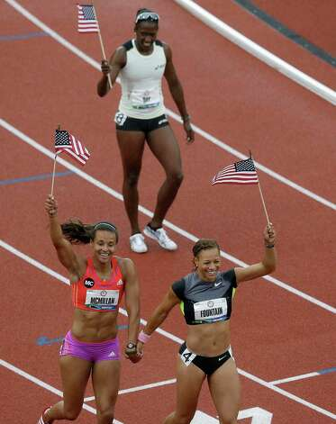 Heptathletes Chantae McMillan, lower left, Hyleas Fountain, lower right, and Sharon Day, rear, celebrate making the Olympic team at the U.S. Olympic Track and Field Trials Saturday, June 30, 2012, in Eugene, Ore. (AP Photo/Charlie Riedel) Photo: Associated Press
