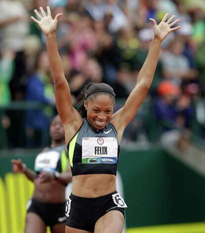 Allyson Felix celebrates her first place finish in the women's 200 meters at the U.S. Olympic Track and Field Trials Saturday, June 30, 2012, in Eugene, Ore. (AP Photo/Marcio Jose Sanchez) Photo: Associated Press