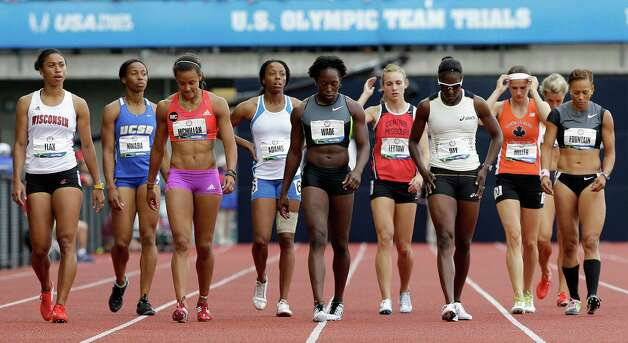 The heptathletes wait for the 800 meters to start at the U.S. Olympic Track and Field Trials Saturday, June 30, 2012, in Eugene, Ore. (AP Photo/Eric Gay) Photo: Associated Press
