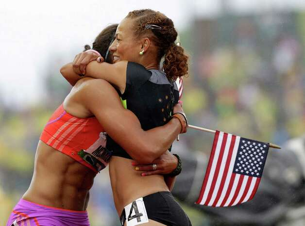 Heptathletes Chantae McMillan, left, and Hyleas Fountain celebrate making it to the Olympics at the U.S. Olympic Track and Field Trials Saturday, June 30, 2012, in Eugene, Ore.(AP Photo/Eric Gay) Photo: Associated Press