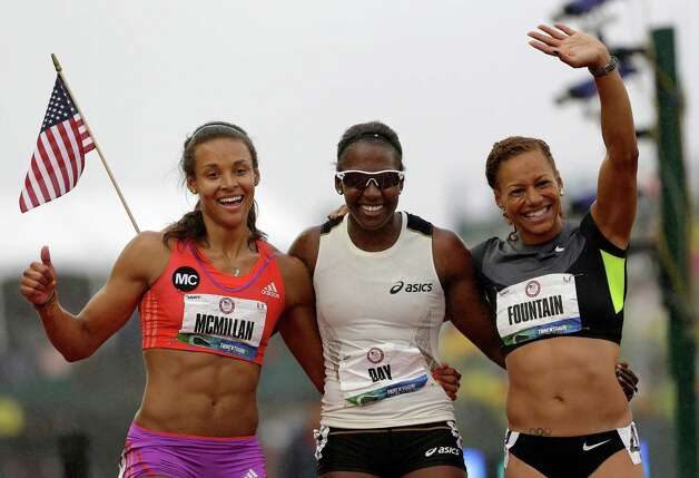 Heptathletes Chantae McMillan, left, Sharon Day, center, and Hyleas Fountain celebrate making it to the Olympics at the U.S. Olympic Track and Field Trials Saturday, June 30, 2012, in Eugene, Ore. (AP Photo/Eric Gay) Photo: Associated Press