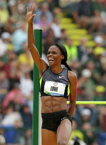 Chaunte Lowe reacts after clearing her height in the women's high jump final at the U.S. Olympic Track and Field Trials Saturday, June 30, 2012, in Eugene, Ore. (AP Photo/Marcio Jose Sanchez) Photo: Associated Press