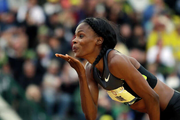 Chaunte Lowe blows a kiss to the crowd during the women's high jump at the U.S. Olympic Track and Field Trials Saturday, June 30, 2012, in Eugene, Ore. (AP Photo/Matt Slocum) Photo: Associated Press