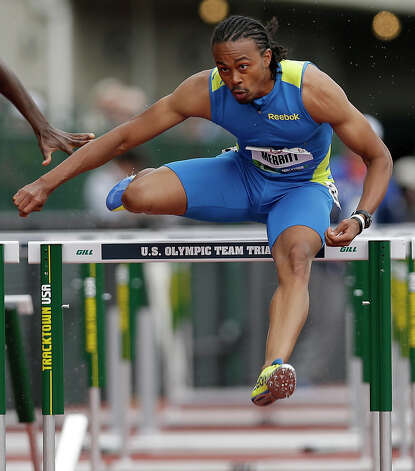 Aries Merritt competes in the semi-finals of the men's 110 meter hurdles at the U.S. Olympic Track and Field Trials Saturday, June 30, 2012, in Eugene, Ore. (AP Photo/Marcio Jose Sanchez) Photo: Associated Press