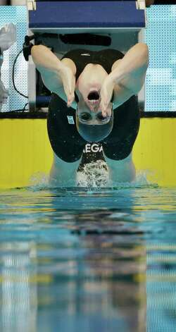 Missy Franklin swims to victory in the women's 200-meter backstroke final at the U.S. Olympic swimming trials, Sunday, July 1, 2012, in Omaha, Neb. (AP Photo/Mark Humphrey) Photo: Associated Press