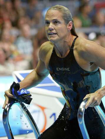 Dara Torres leaves the pool after swimming in the women's 50-meter freestyle preliminaries at the U.S. Olympic swimming trials, Sunday, July 1, 2012, in Omaha, Neb. (AP Photo/Mark J. Terrill) Photo: Associated Press