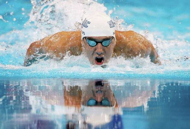 Michael Phelps swims to victory in the men's 100-meter butterfly final at the U.S. Olympic swimming trials on Sunday, July 1, 2012, in Omaha, Neb. (AP Photo/Mark Humphrey) Photo: Associated Press