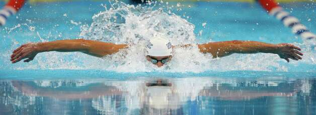 Michael Phelps swims to victory in the men's 100-meter butterfly final at the U.S. Olympic swimming trials, Sunday, July 1, 2012, in Omaha, Neb. (AP Photo/Mark Humphrey) Photo: Associated Press