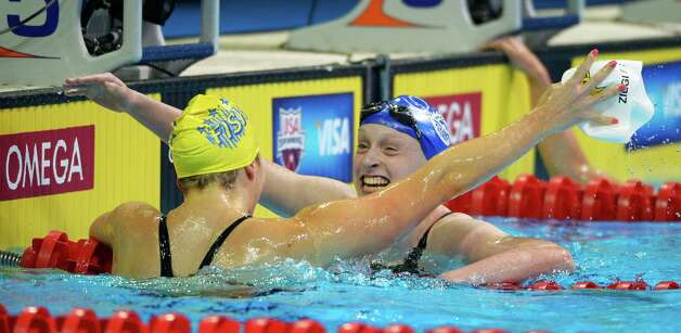 Kathleen Ledecky celebrates with Kate Ziegler, left, after winning the women's 800-meter freestyle final at the U.S. Olympic swimming trials, Sunday, July 1, 2012, in Omaha, Neb. (AP Photo/Mark J. Terrill) Photo: Associated Press