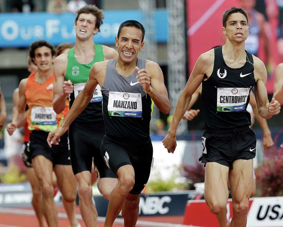 Leo Manzano (center), pictured running the 1,500 meters at June's U.S. Olympic trials, competes today in London. (AP Photo/Eric Gay) Photo: Associated Press