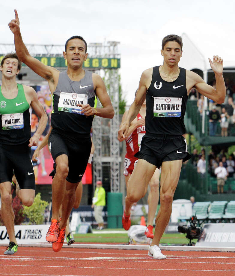 Leonel Manzano leads Matthew Centrowitz to the finish in the men's 1500 meter final at the U.S. Olympic Track and Field Trials Sunday, July 1, 2012, in Eugene, Ore. Manzano came in first and Centrowitz crossed second. Both made the Olympic team.  (AP Photo/Eric Gay) Photo: Associated Press