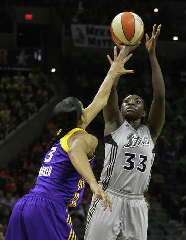 Silver Stars' Sophia Young (33) shoots over the Los Angeles Sparks' Candace Parker (03) in the first half of a WNBA basketball game at the AT&T Center, Thursday, June 28, 2012. The Silver Stars defeated the Sparks 94-80. (AP Photo/San Antonio Express-News, Kin Man Hui)  MAGAZINES OUT; TV OUT; NO SALES; SAN ANTONIO OUT; AP MEMBERS ONLY; MANDATORY CREDIT Photo: AP