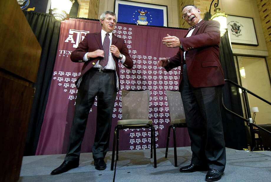 Texas A&M president R. Bowen Loftin (right) welcomes Eric Hyman as the Aggies' new athletic director with open arms on Saturday. Photo: Stuart Villanueva, College Station Eagle