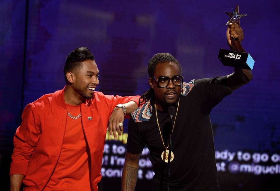 LOS ANGELES, CA - JULY 01:  Recording artists Miguel (L) and Wale accept the award for Best Collaboration onstage during the 2012 BET Awards at The Shrine Auditorium on July 1, 2012 in Los Angeles, California. Photo: Michael Buckner, Getty Images For BET / 2012 Getty Images
