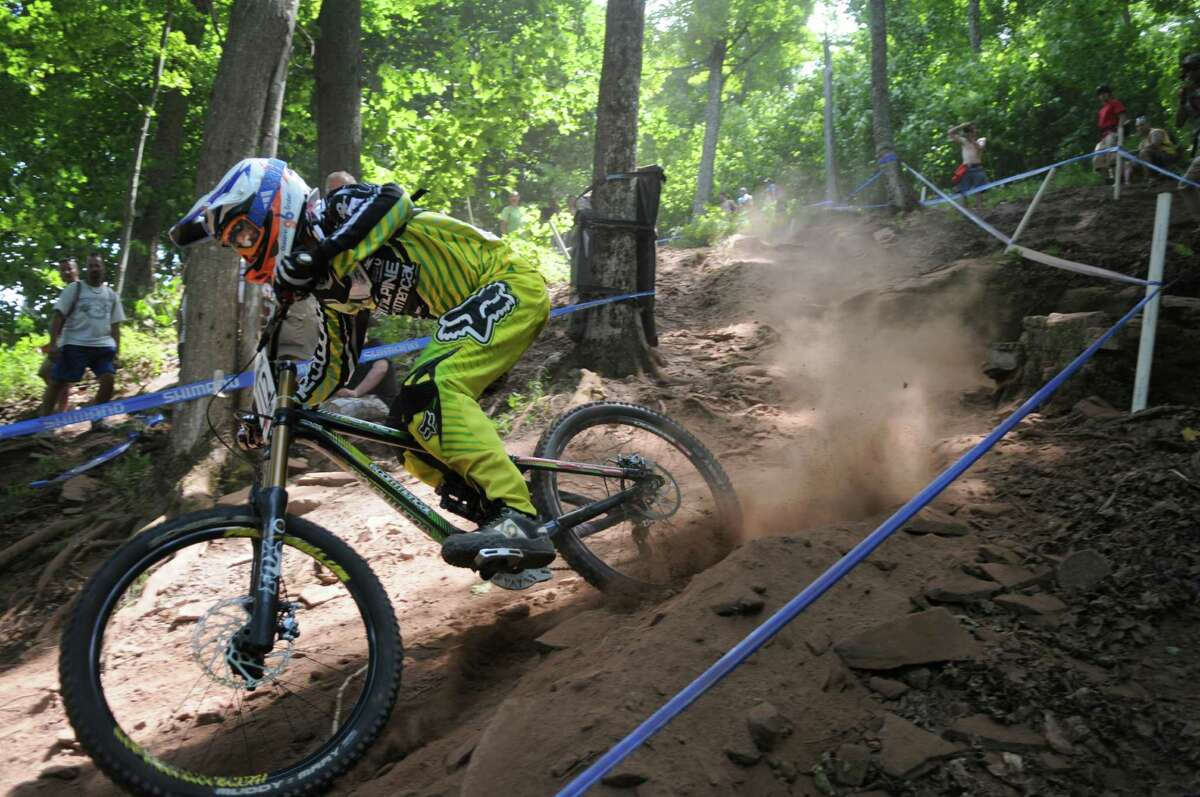 Manuel Gruber heads down the mountain during the UCI Mountain Bike World Cup men's downhill final race at Windham Mountain on Sunday July 1, 2012 in Windham, NY. (Philip Kamrass / Times Union)