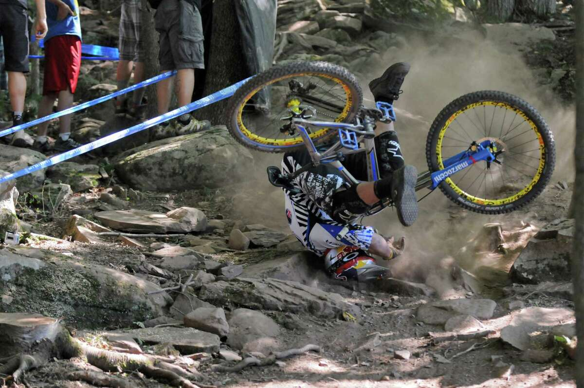 Brook MacDonald crashes in the Rock Garden section of the UCI Mountain Bike World Cup men's downhill final race at Windham Mountain on Sunday July 1, 2012 in Windham, NY. MacDonald got up and continued, finishing 34th out of 78 places. (Philip Kamrass / Times Union)