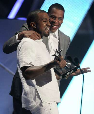 "Kanye West, left, and Jay-Z accept the award for best group for  ""The Throne"" at the BET Awards on Sunday,  July 1, 2012, in Los Angeles. (Photo by Matt Sayles/Invision/AP) Photo: AP"