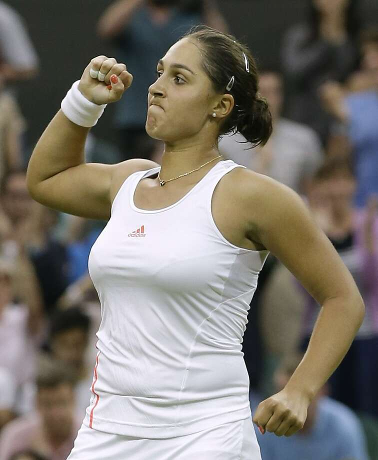 Tamira Paszek of Austria gives the overworked fist pump, now done for every little thing, after her first-round singles match. Photo: Kirsty Wigglesworth, Associated Press