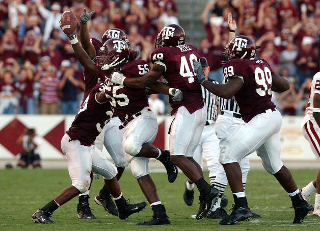 6. Oklahoma upset: Texas A&M's Randall Webb (55) gets congratulated by teammates after he recovers an Oklahoma fumble which lead to a touchdown to give the Aggies a 30-26 win at Kyle Field Stadium on Saturday, Nov. 9, 2002. Photo: Kin Man Hui, San Antonio Express-News