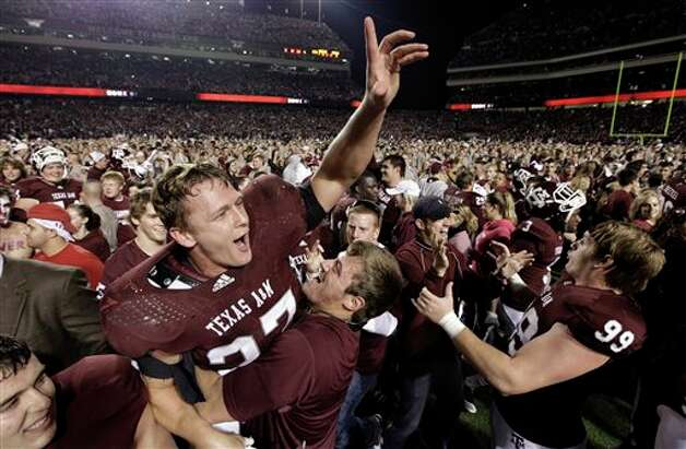 8. The streak: Texas A&M linebacker Michael Hodges (37) is lifted up as he celebrates after beating Nebraska Saturday, Nov. 20, 2010, in College Station. Photo: David J. Phillip, Associated Press