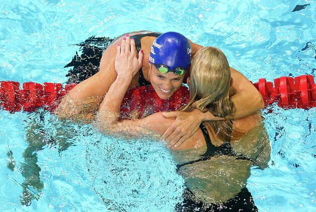 Dara Torres (top) hugs Jessica Hardy following their semifinal women's 50 meter freestyle during the U.S. Olympic Team Trials for swimming at the CenturyLink Center Omaha Sunday evening, July 1, 2012.  Hardy had the top qualifying time at 24.56 while Torres qualified third at 24.80.  (AP Photo/The Omaha World-Herald/Rebecca S. Gratz) Photo: Associated Press