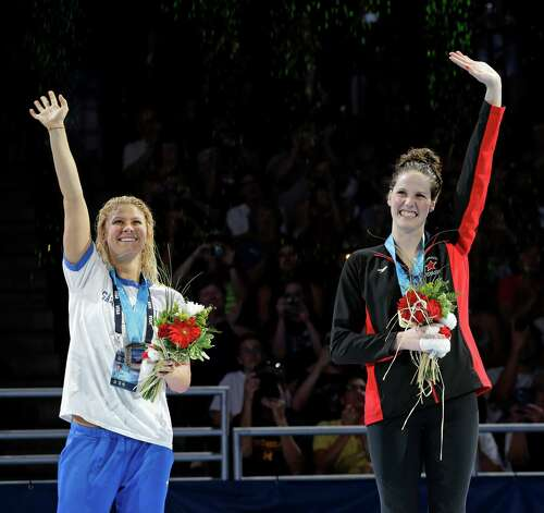 Elizabeth Beisel, left, and Missy Franklin wave during the medal ceremony for the women's 200-meter backstroke at the U.S. Olympic swimming trials on Sunday, July 1, 2012, in Omaha, Neb. (AP Photo/Mark Humphrey) Photo: Associated Press