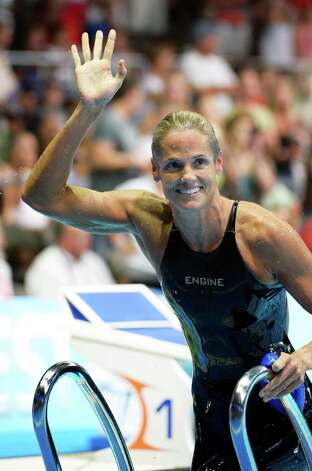 Dara Torres waves after swimming in the women's 50-meter freestyle semifinal at the U.S. Olympic swimming trials, Sunday, July 1, 2012, in Omaha, Neb. (AP Photo/Mark J. Terrill) Photo: Associated Press