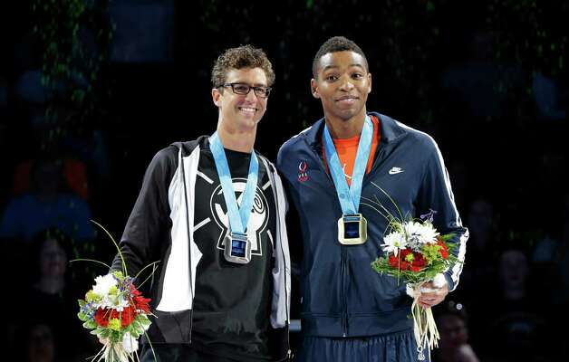 Anthony Ervin, left, and Cullen Jones pose during the medal ceremony for the men's 50-meter freestyle at the U.S. Olympic swimming trials on Sunday, July 1, 2012, in Omaha, Neb. (AP Photo/Mark Humphrey) Photo: Associated Press