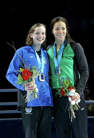 Kathleen Ledecky, left, and Kate Ziegler pose during the medal ceremony for the women's 800-meter freestyle at the U.S. Olympic swimming trials on Sunday, July 1, 2012, in Omaha, Neb. (AP Photo/Mark Humphrey) Photo: Associated Press