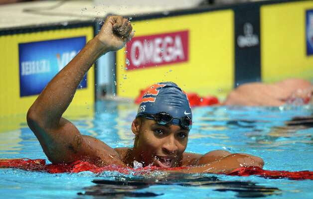 Cullen Jones celebrates after winning the men's 50-meter freestyle final at the U.S. Olympic swimming trials, Sunday, July 1, 2012, in Omaha, Neb. (AP Photo/Mark J. Terrill) Photo: Associated Press