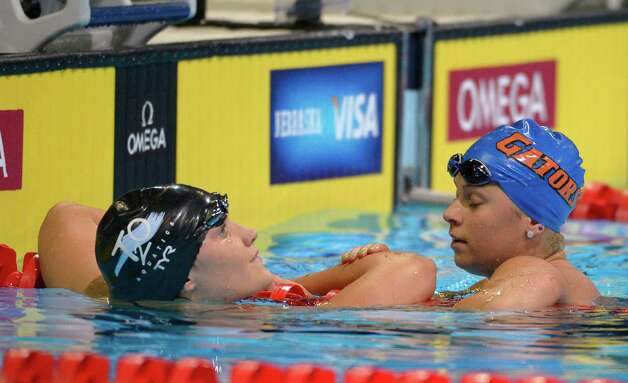 Elizabeth Pelton, left, talks to Elizabeth Beisel after swimming in the women's 200-meter backstroke final at the U.S. Olympic swimming trials, Sunday, July 1, 2012, in Omaha, Neb. (AP Photo/Mark J. Terrill) Photo: Associated Press