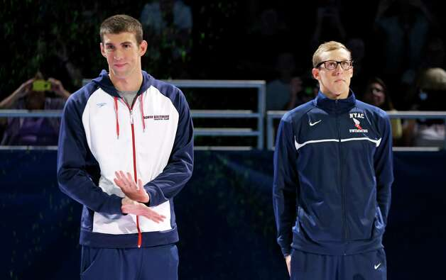 Michael Phelps, left, stands with Tyler McGill during the medal ceremony for the men's 100-meter butterfly at the U.S. Olympic swimming trials on Sunday, July 1, 2012, in Omaha, Neb. (AP Photo/Mark Humphrey) Photo: Associated Press