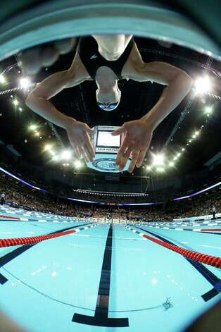 Madison Kennedy dives at the start of a women's 50-meter freestyle semifinal at the U.S. Olympic swimming trials on Sunday, July 1, 2012, in Omaha, Neb. (AP Photo/Mark Humphrey) Photo: Associated Press