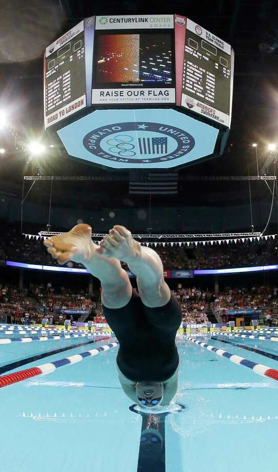 Madison Kennedy dives at the start of the women's 50-meter freestyle semifinal at the U.S. Olympic swimming trials on Sunday, July 1, 2012, in Omaha, Neb. (AP Photo/Mark Humphrey) Photo: Associated Press