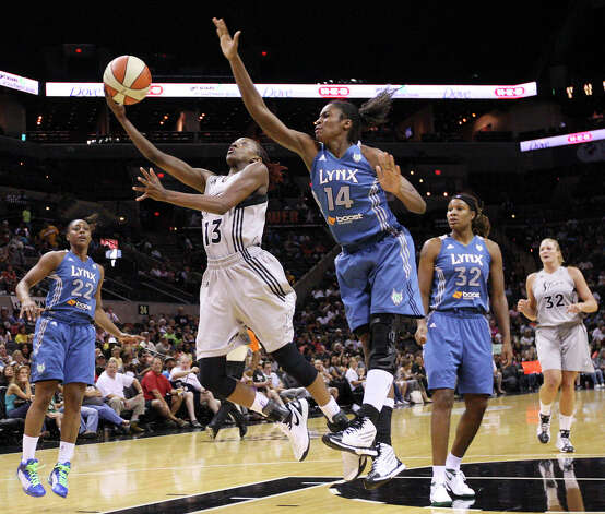 The Silver Stars' Danielle Robinson shoots around the Minnesota Lynx's Devereaux Peters during second half action on Sunday, July 1, 2012, at the AT&T Center. The Silver Stars won 93-84. Photo: Edward A. Ornelas, San Antonio Express-News / © 2012 San Antonio Express-News