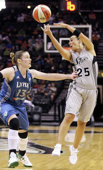 The Silver Stars' Becky Hammon passes over the Minnesota Lynx's Lindsay Whalen during first half action on Sunday, July 1, 2012, at the AT&T Center. Photo: Edward A. Ornelas, San Antonio Express-News / © 2012 San Antonio Express-News