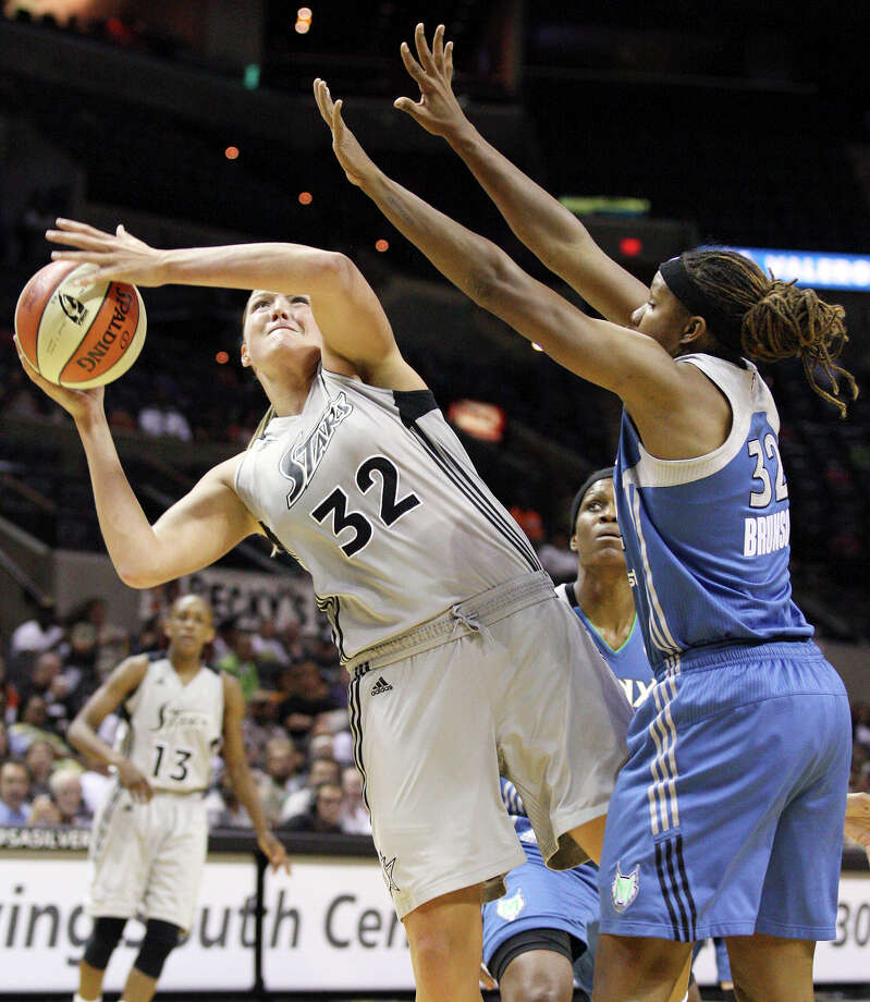 The Silver Stars' Jayne Appel shoots around the Minnesota Lynx's Rebekkah Brunson during first half action on Sunday, July 1, 2012, at the AT&T Center. Photo: Edward A. Ornelas, San Antonio Express-News / © 2012 San Antonio Express-News