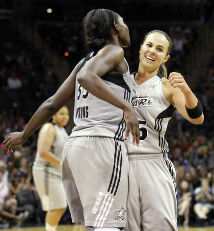 The Silver Stars' Sophia Young (left) and Becky Hammon celebrate after Young scored during second half action against the Minnesota Lynx on Sunday, July 1, 2012, at the AT&T Center. The Silver Stars won 93-84. Photo: Edward A. Ornelas, San Antonio Express-News / © 2012 San Antonio Express-News