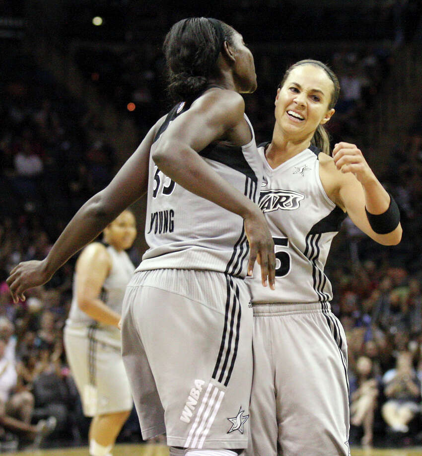 The Silver Stars' Sophia Young (left) and Becky Hammon celebrate after Young scored during second half action against the Minnesota Lynx on Sunday, July 1, 2012, at the AT&T Center. The Silver Stars won 93-84.