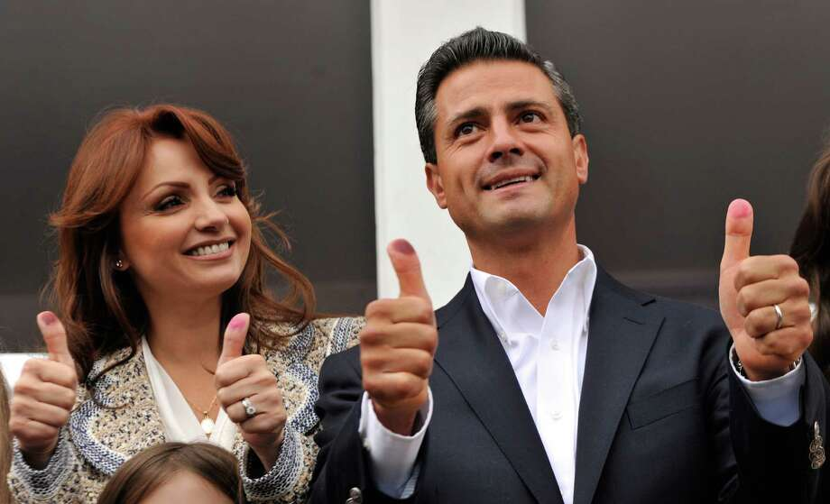 Enrique Peña Nieto of the Institutional Revolutionary Party, or PRI, casts his vote with wife Angélica Rivero de Peña. Late Sunday he had 38 percent of the vote. Photo: Daniel Aguilar / 2012 Getty Images