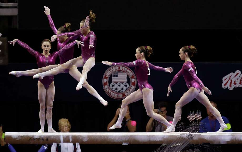 In this multiple exposure photo shot at one quarter of a second intervals, McKayla Maroney competes on the balance beam during the final round of the women's Olympic gymnastics trials, Sunday, July 1, 2012, in San Jose, Calif. Maroney was named to the U.S. Olympic gymnastics team. (AP Photo/Julie Jacobson) Photo: Associated Press