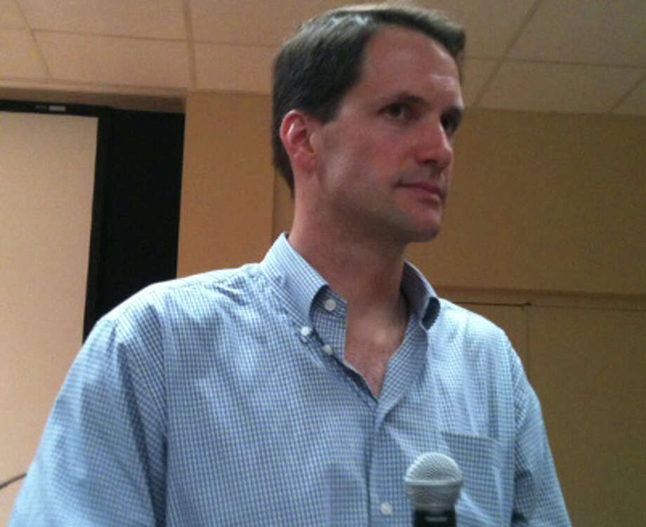 U.S. Rep. Jim Himes, D-4, listens to a constituent's questions during a public forum Sunday at the Westport Public Library. Photo: Andrew Brophy / Westport News contributed