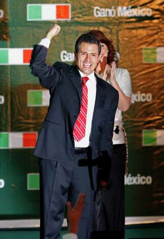 Presidential candidate Enrique Pena Nieto gestures to supporters at his party's headquarters in Mexico City, early Monday, July 2, 2012. Mexico's federal elections institute's preliminary count says Pena Nieto has won the presidency. The candidate for the old-ruling Institutional Revolutionary Party, or PRI, has won about 38 percent of the vote according a representative count of the ballots.  (AP Photo/Marco Ugarte) Photo: Marco Ugarte