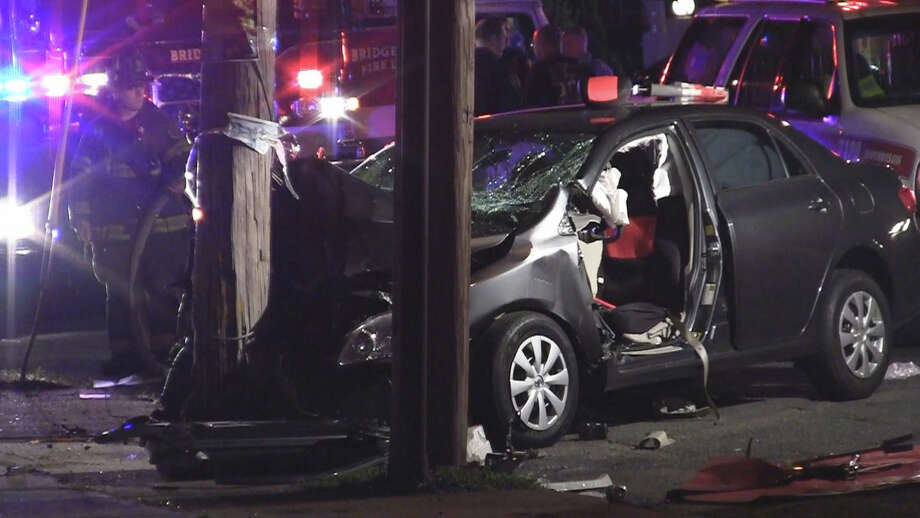 Four people were hospitalized - two with serious injuries - after a car slammed into a telephone pole on Fairfield Avenue in Bridgeport, Conn. early Sunday morning, July 1, 2012. Photo: Steve Krauchick