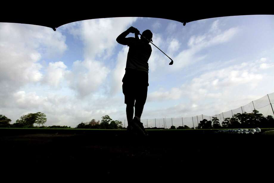 Golfer John Koval practice his golf swing at Memorial Park Golf Course on Monday, July 2, 2012, in Houston. Photo: Mayra Beltran, Houston Chronicle / © 2012 Houston Chronicle