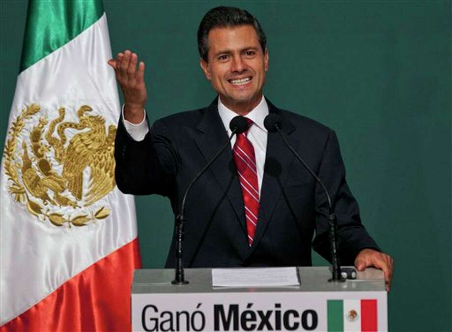 Presidential candidate Enrique Pena Nieto speaks to supporters at his party's headquarters in Mexico City, early Monday, July 2, 2012. Mexico's federal elections institute's preliminary count says Pena Nieto has won the presidency. The candidate for the old-ruling Institutional Revolutionary Party, or PRI, has won about 38 percent of the vote according a representative count of the ballots.  (AP Photo/Christian Palma) Photo: Christian Palma, Associated Press / AP