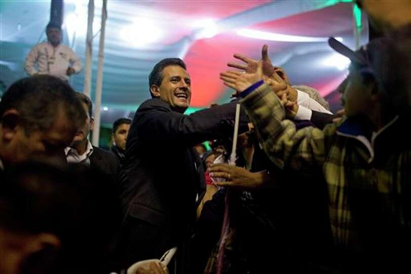 Enrique Pena Nieto, presidential candidate for the Revolutionary Institutional Party (PRI), center,