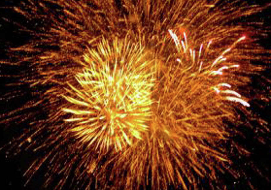 Westport's annual fireworks display for the Independence Day holiday will take place Tuesday night over Compo Beach. Photo: File Photo / Westport News