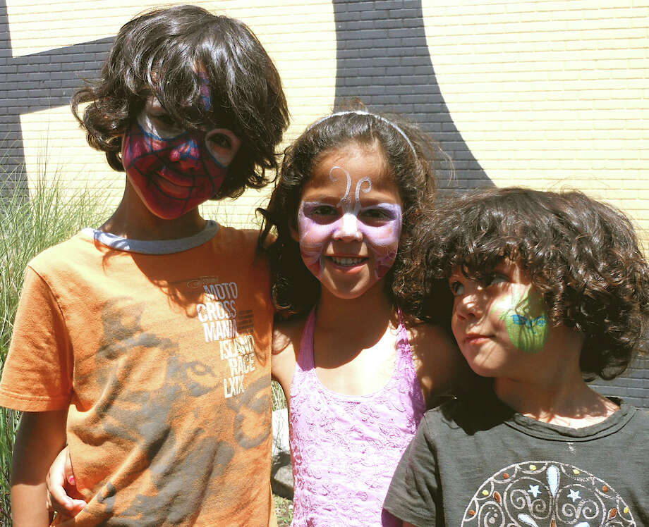 Paul, Lila and Emilio Reyes show off their painted faces at the Fairfield Theatre Comonay's Back Lot BBQ on Saturday. Photo: Mike Lauterborn / Fairfield Citizen contributed